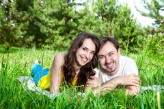 Couple on green grass Royalty Free Stock Images