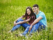 Couple on green grass. Royalty Free Stock Photography