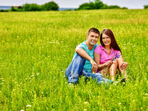 Couple on green grass Royalty Free Stock Photography