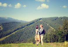 Couple on the green grass meadow. Happy beautiful couple on the green grass meadow royalty free stock photography