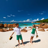 Couple in green having fun on a beach at Seychelles Stock Images