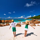Couple in green having fun on a beach at Seychelles Royalty Free Stock Photos