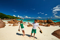 Couple in green having fun on a beach at Seychelles Royalty Free Stock Images