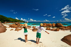 Couple in green having fun on a beach at Seychelles Stock Image