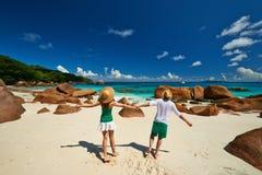 Couple in green having fun on a beach at Seychelles Stock Photos