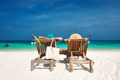 Couple in green relax on a beach at Maldives Royalty Free Stock Photo