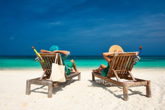 Couple in green relax on a beach at Maldives Stock Photo