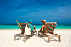 Couple in green relax on a beach at Maldives Royalty Free Stock Photos