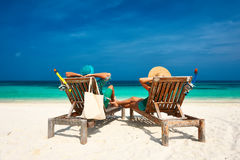 Couple in green relax on a beach at Maldives Stock Images