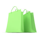 Couple of green shopping bags. 3D rendering of two green shopping bags against a white background Stock Photography