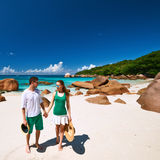 Couple in green walking on a beach at Seychelles Royalty Free Stock Photo