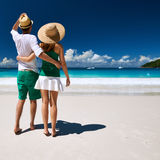 Couple in green walking on a beach at Seychelles Royalty Free Stock Images