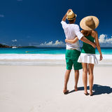 Couple in green walking on a beach at Seychelles Royalty Free Stock Image