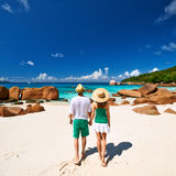 Couple in green walking on a beach at Seychelles Royalty Free Stock Photos