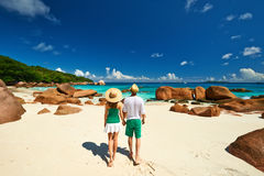 Couple in green walking on a beach at Seychelles Royalty Free Stock Photography