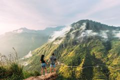 The couple greets the sunrise in the mountains stock photos