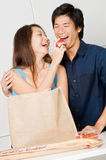 Couple with Groceries. An attractive couple unpacking groceries in the kitchen at home Stock Image
