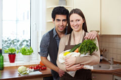 Couple with groceries Royalty Free Stock Image