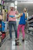 Couple At Groceries Store Buy Trash Can Stock Photo