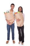 Couple With A Grocery Bag Royalty Free Stock Photo