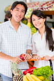 Couple grocery shopping Stock Photography
