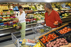 Couple grocery shopping. Stock Image