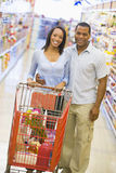 Couple grocery shopping Stock Image