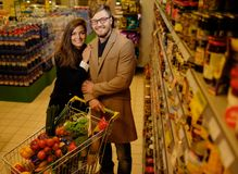 Couple in a grocery store Stock Photos