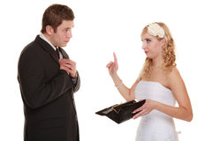 Couple groom and bride with empty purse, conflict. Royalty Free Stock Photo