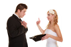 Couple groom and bride with empty purse, conflict. Stock Image
