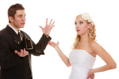 Couple groom and bride with empty purse, conflict. Royalty Free Stock Photos