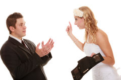 Couple groom and bride with empty purse, conflict. Stock Images