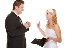 Couple groom and bride with empty purse, conflict. Royalty Free Stock Images