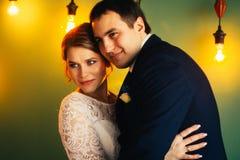 Couple groom and bride in light studio Stock Image