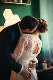 Couple groom and bride in light studio Royalty Free Stock Photography