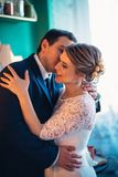 Couple groom and bride in light studio Royalty Free Stock Images