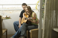 Couple with Guitar Royalty Free Stock Images