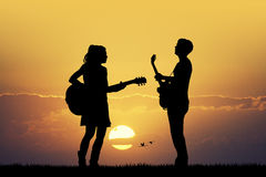 Couple with guitars Stock Image