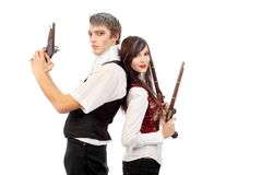 Couple with guns Stock Images