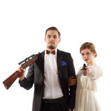 Couple with guns. A romantic couple holding a handgun and a rifle Royalty Free Stock Photography