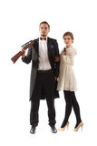 Couple with guns. A couple wearing fancy clothes and holding guns Royalty Free Stock Photo