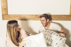 Couple of guy and girl in bed smiling and happy. Girl and guy couple showing affection in bed royalty free stock photos