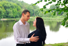 Couple - the guy with the girl looking at each other . Royalty Free Stock Images