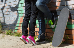 Couple of guys with his skateboard Stock Photos