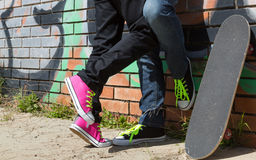 Couple of guys with his skateboard Stock Photography