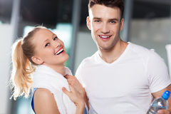 Couple at the gym. Young couple in health club Royalty Free Stock Photo