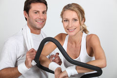 Couple in the gym. Healthy young couple in the gym Royalty Free Stock Photo