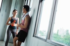 Couple at the gym chating in the break time. After exercising royalty free stock image