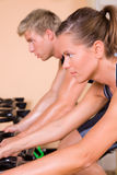 Couple in the gym cycling Royalty Free Stock Images