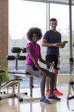 Couple in a gym have break Royalty Free Stock Photo